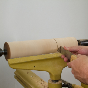 Use a parting tool to separate the mill body and head